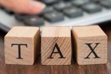 three wooden blocks spelling tax